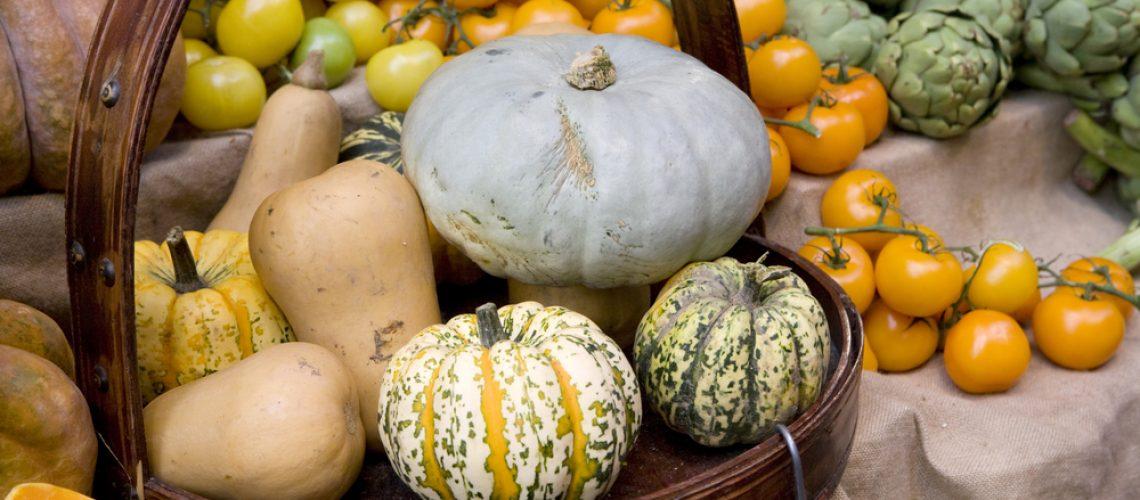Pumkin in basket. vegetables in grossery shop.  Artichoke and tomato