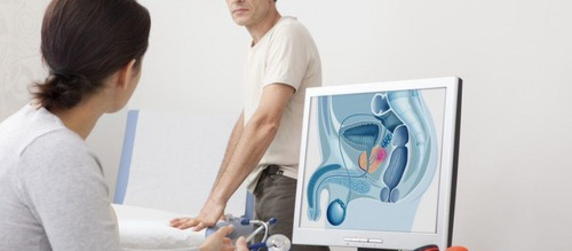 Models.  On screen, drawing representing a prostate cancer.